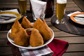 Brazilian coxinha a snack with a bar in the background Stock Photography