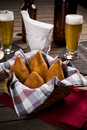 Brazilian coxinha a snack with a bar in the background Royalty Free Stock Image