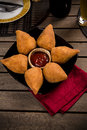 Brazilian coxinha a snack with a bar in the background Royalty Free Stock Photography
