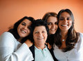 Brazilian family mom and daughters happy with beautiful smile Stock Photos