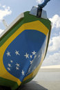 Brazilian flag fishing boat on brazil beach painted with bright colors the in jericoacoara Royalty Free Stock Photo