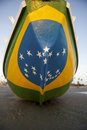 Brazilian flag fishing boat on brazil beach painted with bright colors the in jericoacoara Royalty Free Stock Images