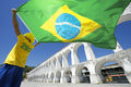Brazilian flag man arcos da lapa arches rio de janeiro in brazil colors waving over brazil Royalty Free Stock Photos