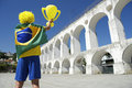 Brazilian flag man arcos da lapa arches rio de janeiro in brazil holding trophy over brazil Stock Photography