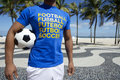 Brazilian football player holding soccer ball copacabana rio wearing international shirt at beach de janeiro Stock Photo