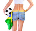 Brazilian football team supporter rear view of sexy woman holding ball and brazil flag isolated on white background body part Royalty Free Stock Photo