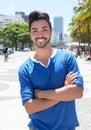 Brazilian guy with crossed arms at Avenida Atlantica at Rio de Janeiro Royalty Free Stock Photo