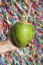 Brazilian hand holding coco gelado wish ribbons salvador bahia drinking coconut at wall of in brazil Stock Photography