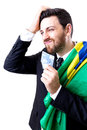 Brazilian not so happy holding Brazilian money and the flag of Brazil Royalty Free Stock Photo