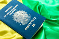 Brazilian passport on the brazilian flag Royalty Free Stock Photo