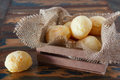 Brazilian snack cheese bread (pao de queijo)  in wooden box with Royalty Free Stock Photo