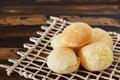 Brazilian snack cheese bread (pao de queijo) on wooden table Royalty Free Stock Photo