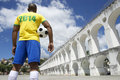 Brazilian soccer football player wears shirt rio holding in brazil colors de janeiro Royalty Free Stock Photos