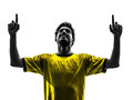 Brazilian soccer football player young happiness joy man silhoue one pointing up in silhouette studio on white background Stock Photo