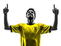 Brazilian soccer football player young happiness joy man silhoue paris france may one pointing up in silhouette at paris france on Stock Photos