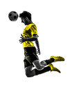 Brazilian soccer football player young man heading silhouette one in studio on white background Stock Photo