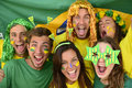 Brazilian sport soccer fans celebrating victory together. Royalty Free Stock Images