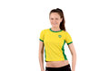 Brazilian sports fan smiling and happy attractive sportive girl with flag on her yellow t shirt isolated on white Royalty Free Stock Photography