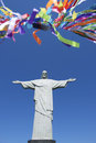 Brazilian wish ribbons lembranca at statue of corcovado colorful also known as or bonfim bracelets christ rio Royalty Free Stock Photos