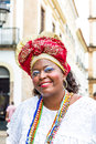 A Brazilian woman of African descent, smiling, wearing traditional clothes from the state of Bahia
