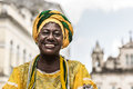 Brazilian woman of african descent wearing traditional clothes from the state of bahia in the old colonial district of salvador Royalty Free Stock Photos
