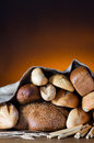 Bread assortment on fireplace background Royalty Free Stock Images
