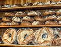 Bread baked according to old German recipes in a small family bakery. Loaves of bread weighing on the shelf Royalty Free Stock Photo