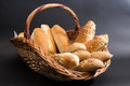 Bread in basket with isolated on dark background Royalty Free Stock Photos