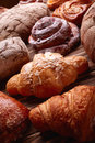 Bread and buns over wooden background tasty homemade Royalty Free Stock Photo