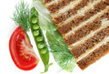 Bread with butter and vegetables Royalty Free Stock Photo