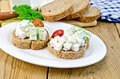 Bread with cheese and tomatoes in white plate sliced tomato dill on a napkin parsley knife on background wooden boards Royalty Free Stock Photos