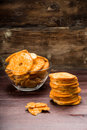 Bread chips flavored with paprika and rosemary on a background Stock Photos