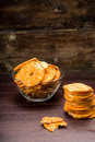 Bread chips flavored with paprika and rosemary on a background Stock Images