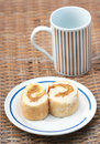 Bread and coffee cup on bamboo table Stock Photo