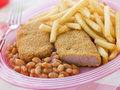Bread crumbed Luncheon Meat with Baked Beans Royalty Free Stock Image