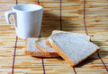 Bread and cup on bamboo plate Stock Photo