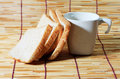 Bread and cup on bamboo plate, Royalty Free Stock Photos