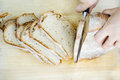 Bread cutting sourdough on a wooden board Royalty Free Stock Photo