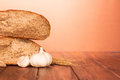 Bread and ears of wheat fresh on wooden background Stock Photos