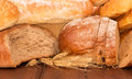 Bread and ears of wheat fresh on wooden background Royalty Free Stock Photo