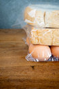 Bread and egg in plastic bag Royalty Free Stock Photo