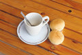 Bread with empty cup of coffee on the yellow wood table Royalty Free Stock Images