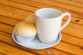 Bread with empty cup of coffee on the yellow wood table Stock Photography