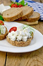 Bread with feta cheese and tomatoes on the board slices of tomato dill a plate napkin a wooden Stock Image