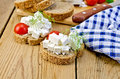 Bread with feta and tomatoes on board with napkin slices of cheese tomato dill a a wooden boards background Stock Image