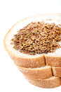 Bread and flex seeds beautiful shot of with on white background Royalty Free Stock Photography