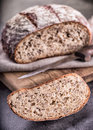 Bread. Fresh bread. Homemade traditional bread. Sliced bread crumbs knife and cumin Royalty Free Stock Photo