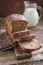 Bread fresh rye on a board with knife Royalty Free Stock Image