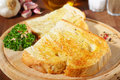 Bread with garlic fresh homemade served on a wooden board Stock Photography
