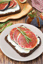 Bread with goat cheese figs honey and rosemary on a plate top view vertical Royalty Free Stock Images